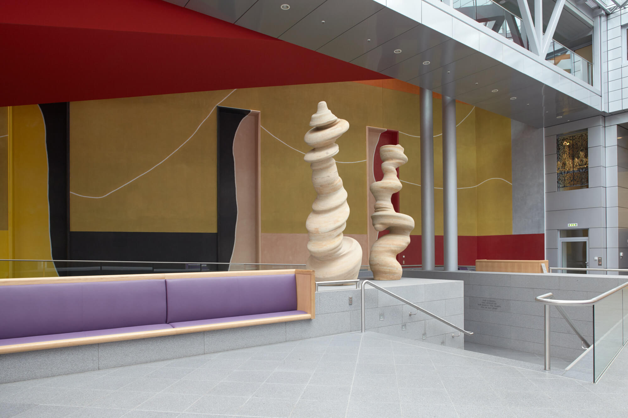 'Dancing Columns', a sculpture by Tony Cragg and behind 'Wall Drawing (for the British Embassy)' by David Tremlett can be seen in the atrium at the British Embassy, Berlin © image: Crown Copyright